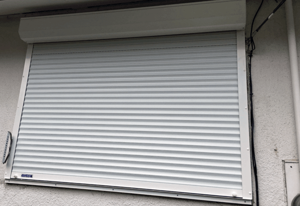 Outside View of House with Roll Shutters
